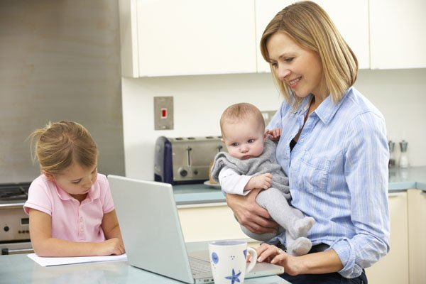 Mother with children business owner working school holidays