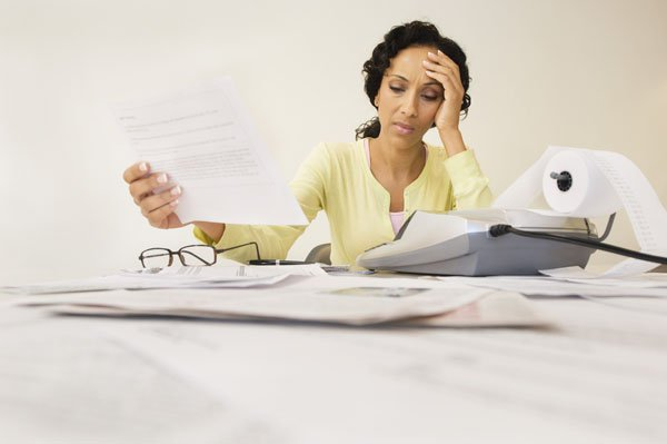business-woman-baffled-by-bookkeeping-and-accounts