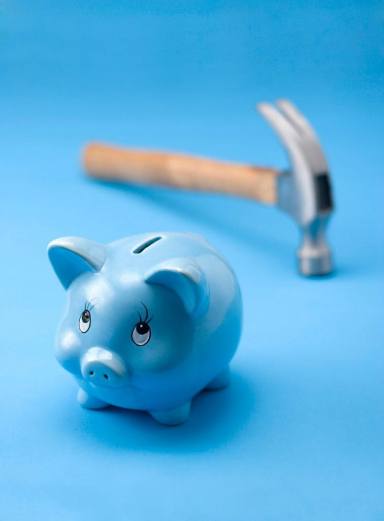 blue-piggy-bank-with-hammer-save-money-reduce-expenses-pricing-strategies